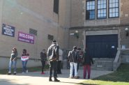 Voters wait outside Washington High School in Milwaukee to be led in to vote. Photo by Isiah Holmes/Wisconsin Examiner.