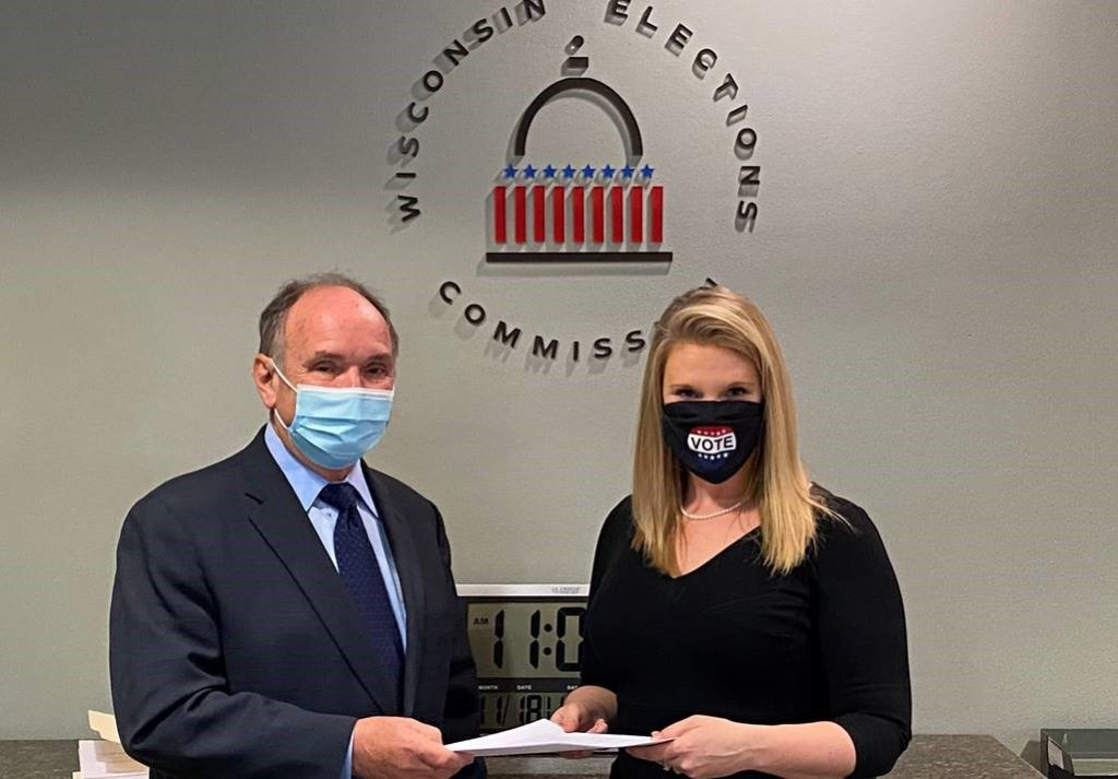 Attorney James Troupis presenting the recount petition to Meagan Wolfe. Photo from the WEC.