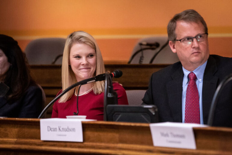 Wisconsin Elections Commission Administrator Meagan Wolfe, left, says her agency has seen no credible evidence of widespread or systemic problems in the Nov. 3 election. Despite that, rumors of vote fraud persist in Wisconsin. Wolfe is seen during a September 2018 meeting of the Elections Commission with Commissioner Dean Knudson. Emily Hamer / Wisconsin Watch