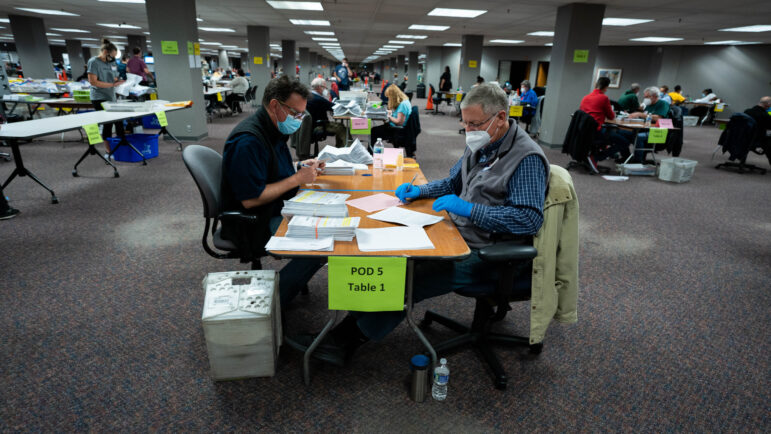 Election workers count ballots at the Milwaukee Central Count location after the polls had closed for the evening, on Nov. 3, 2020. Eric Kleppe-Montenegro for Wisconsin Watch