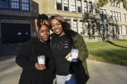 Antoinette Jackson and her sister Elita Williams enjoy coffee and donuts after they cast their votes at Washington High School in Milwaukee on Nov. 3, 2020. A Wisconsin Watch analysis found turnout in majority-Black wards in Milwaukee was down from 2016. Advocates blamed fear of contracting COVID-19, lack of face-to-face voter engagement and suspicion of mail-in voting, the method most Wisconsin voters used on Nov. 3. Sue Vliet for Wisconsin Watch