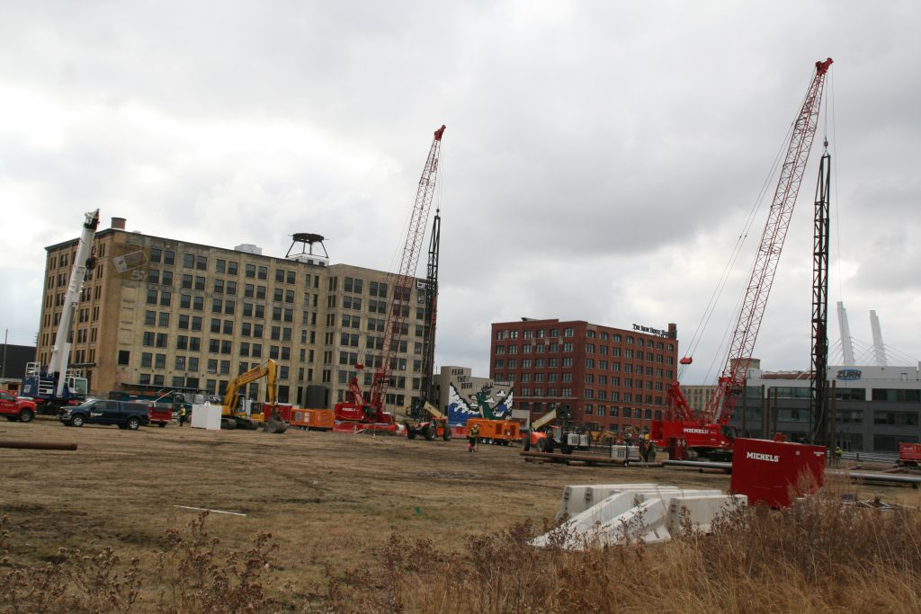 Pile drivers work on a foundation for Rite-Hite's R&D building. Photo by Jeramey Jannene.