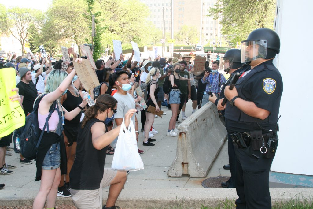 Milwaukee Police Department officers guard the MPD administration building in June 2020. Photo by Jeramey Jannene.