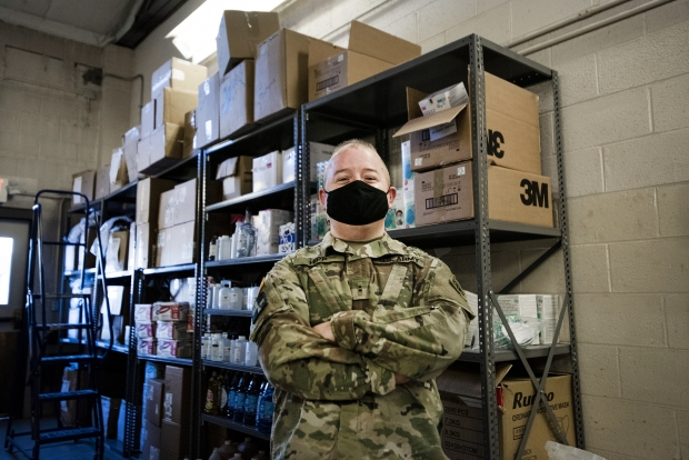 Chief Warrant Officer Matt Hipp at the PPE warehouse in Madison. Members of the Wisconsin National Guard distribute PPE and other gear to COVID-19 testing sites across the state. Angela Major/WPR