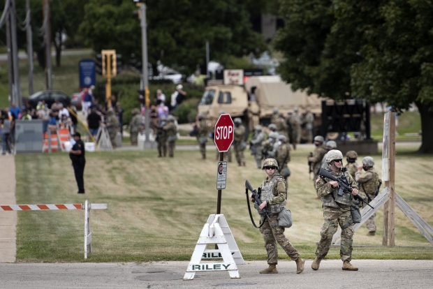 Members of the Wisconsin National Guard stand outside of Bradford High School during President Donald Trump's visit to Kenosha on Tuesday, Sep. 1, 2020. Angela Major/WPR
