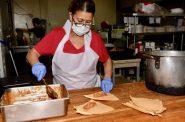 An employee prepares tamales. Photo by Sue Vliet/NNS.
