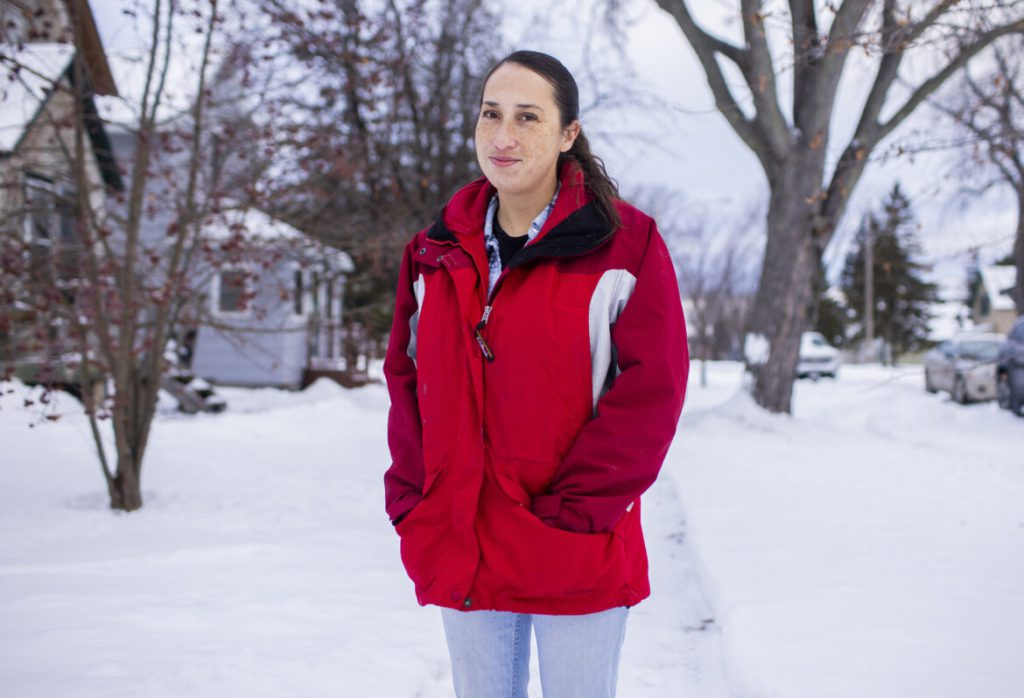 Alishia Abarca stands outside her mother's home on Saturday, Dec. 26, 2020 in Superior, Wis. Abarca has never voted and does not plan to until politicians take a salary closer to what she's making so they can understand her reality. She also thinks lobbyists and corporations have corrupted the political system and anyone participating in that system risks becoming ensnared in the corruption. Derek Montgomery for Wisconsin Watch