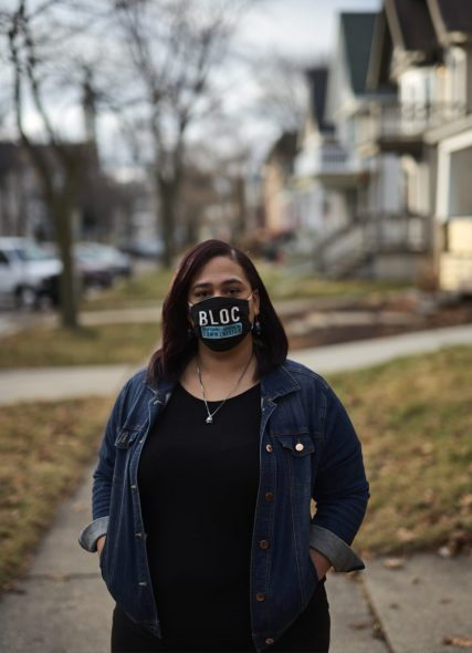Angela Lang from BLOC, a community organization that focuses on informing and empowering residents, stands outside her home on Dec. 22, 2020 in Milwaukee. Lang is among the activists who worked to turn out the vote in predominantly Black communities in the city. Darren Hauck for Wisconsin Watch