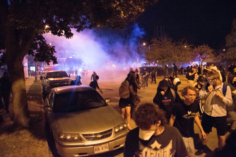 A crowd disperses as police deploy tear gas during a protest in downtown Madison, Wis., on Aug. 24, 2020. The protest came in response to the police shooting of Jacob Blake in Kenosha, Wis., one day earlier. Will Cioci / Wisconsin Watch