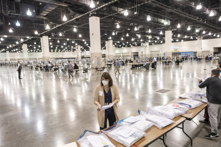 Claire Woodall-Vogg, executive director of the Milwaukee Election Commission, works at the presidential recount at the Wisconsin Center convention center in Milwaukee on Nov. 25, 2020. Sara Stathas for Wisconsin Watch