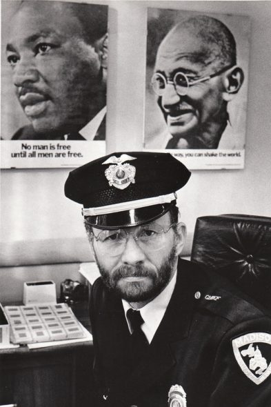 """Posters of Martin Luther King Jr. and Mahatma Gandhi hung in David Couper's office during his tenure as Madison's police chief from 1972 to 1993. The posters carry the messages: """"No man is free until all are free,"""" and """"In a gentle way, you can shake the world."""" Couper — now an Episcopal priest, poet and peace activist — says the assassination of King in 1968 helped him realize police """"had to do something different"""" to keep the peace and earn residents' trust. Courtesy of David Couper"""