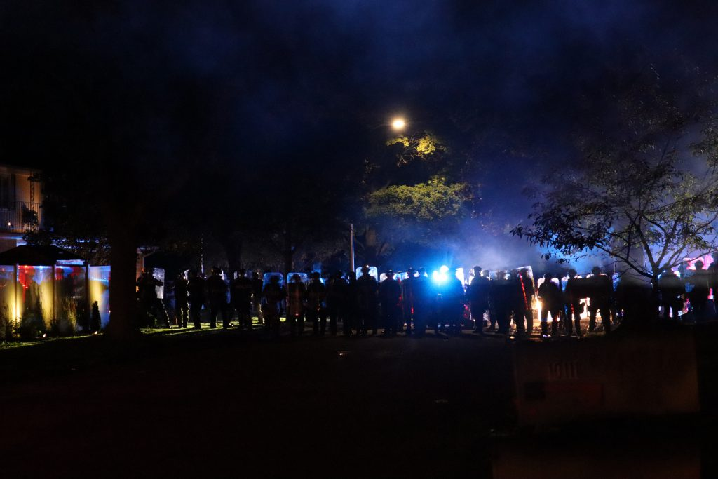 Police block a road during the October Wauwatosa curfew, after having just shot rubber bullets and tear gas at protesters and their cars. Photo by Isiah Holmes/Wisconsin Examiner.