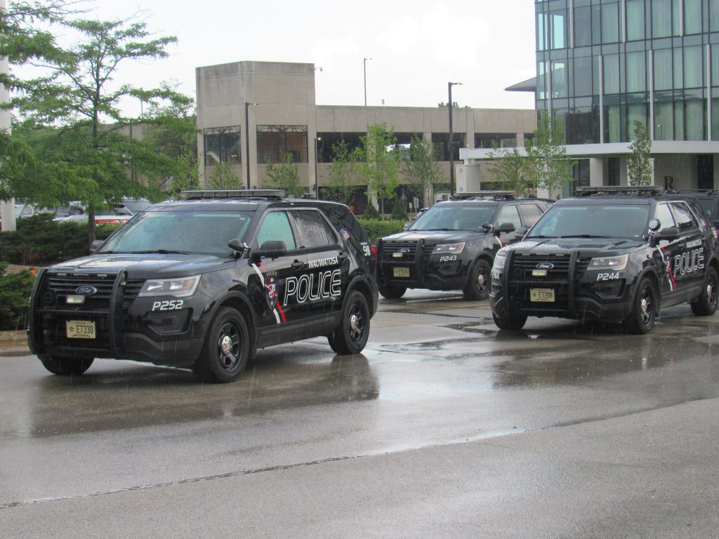 Wauwatosa Police Department squad cars responding during a standoff with protesters on July 7, 2020. Photo by Isiah Holmes/Wisconsin Examiner.