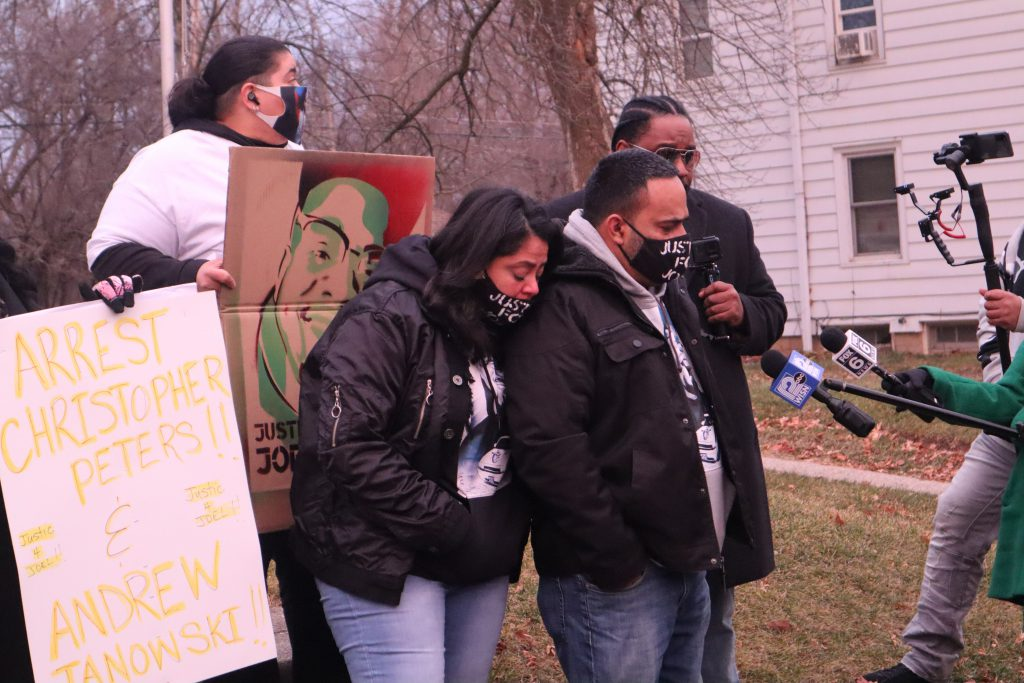 The family of Joel Acevedo stand in from of Michael Mattioli's former home shortly before Christmas eve, 2020. Photo by Isiah Holmes/Wisconsin Examiner.