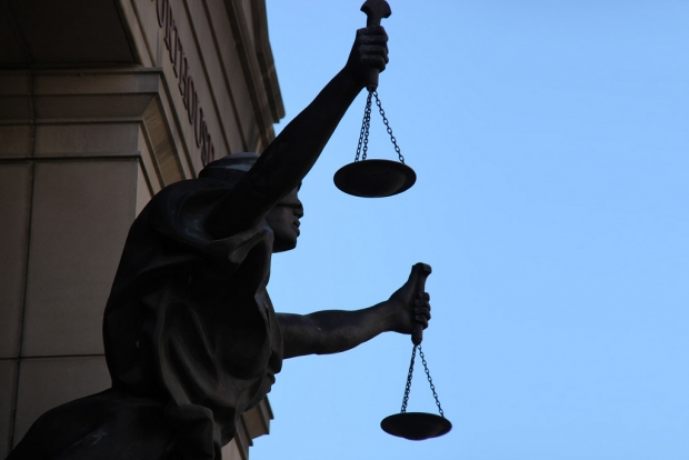 Scales of Justice Statue. Photo by Tim Evanson. (CC-BY-SA) https://creativecommons.org/licenses/by-sa/2.0/