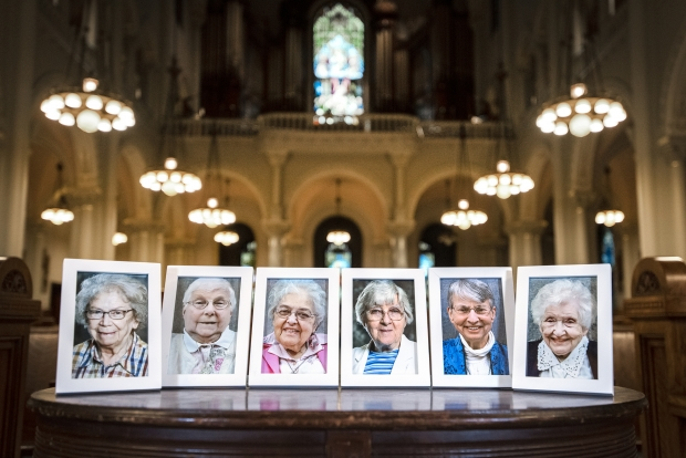 From left, photos of Sister Mary Francele Sherburne, Sister Josephine Seier, Sister Bernadette Kelter, Sister Mary Regine Collins, Sister Marie June Skender and Sister Annelda Holtkamp can be seen inside of a chapel in Milwaukee. The six died from complications of COVID-19. Angela Major/WPR