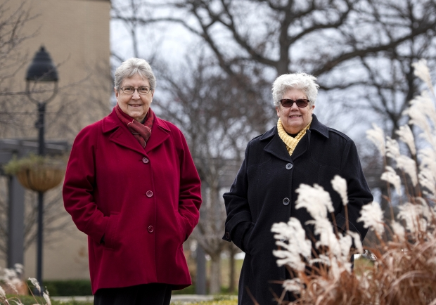 Sister Mary Diez, left, and Sister Kathleen O'Brien stand together at Alverno College. Angela Major/WPR