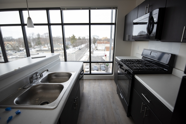 A kitchen in a corner unit at Que El-Amin's Villard Commons development in Milwaukee has an expansive view of the area. Angela Major/WPR