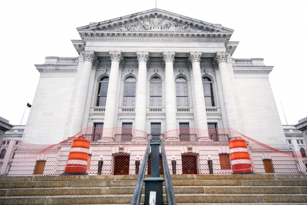 Cones and fencing are put up to block off an area outside of the Wisconsin State Capitol on Sunday, Jan. 17, 2021, in Madison, Wis. Angela Major/WPR