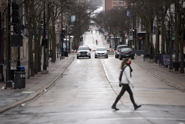 Police blocked off streets around the Wisconsin State Capitol on Sunday, Jan. 17, 2021, in Madison, Wis. Angela Major/WPR