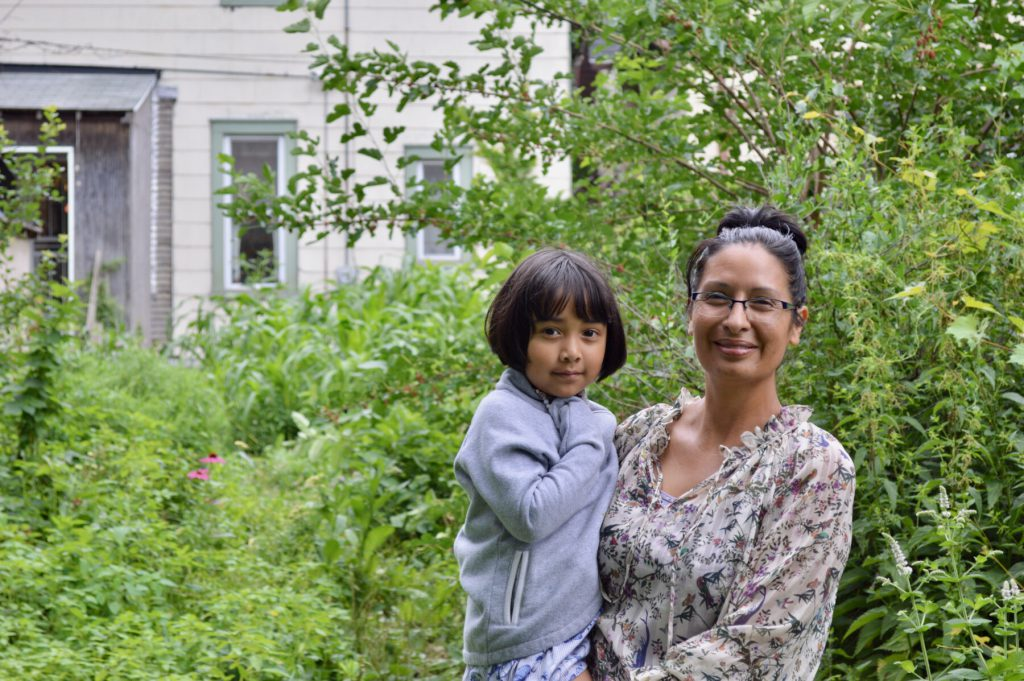 Angela Kingsawan says the earth communicates with her through her garden, which encompasses her backyard. Photo by Ana Martinez-Ortiz/NNS.