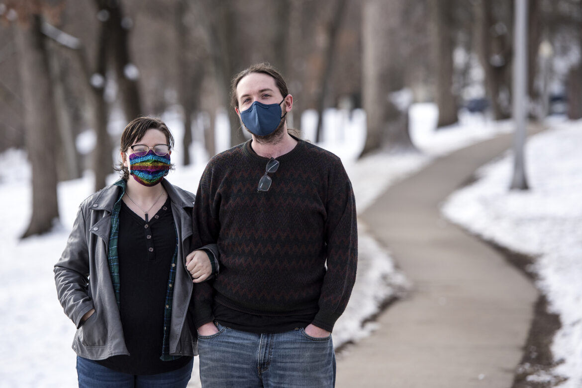 Andrew Seiner, right, stands with his wife, Morganne Seiner, left, on Jan. 9, 2021, at Firemen's Park in Waterloo, Wis. Morgan received a COVID-19 diagnosis on New Year's Day, prompting the couple to improvise ways to limit Andrew's exposure while inside of their home. Angela Major / WPR
