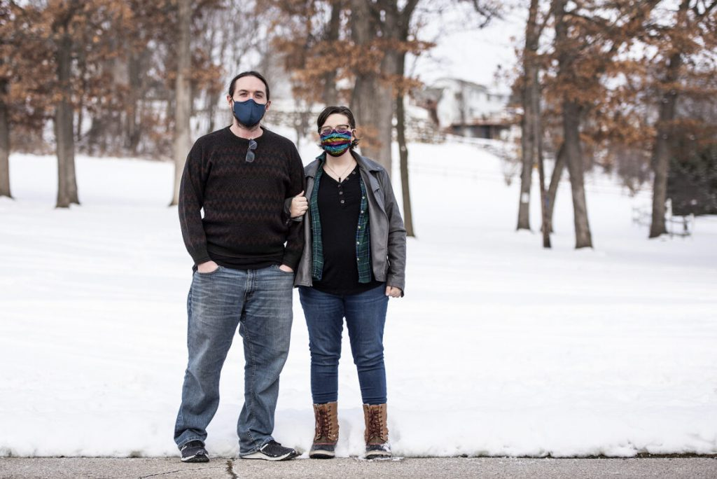 "Morganne Seiner, right, stands with her husband, Andrew Seiner, left, on Jan. 9, 2021, at Firemen's Park in Waterloo, Wis. After isolating throughout the pandemic, Morganne received a COVID-19 diagnosis on New Year's Day, following a Christmas visit to her sister's home. ""You can be so careful, and you can just make one mistake. You can just let your guard down a little bit, and that's when that's when it could get you,"" she says. Angela Major / WPR"