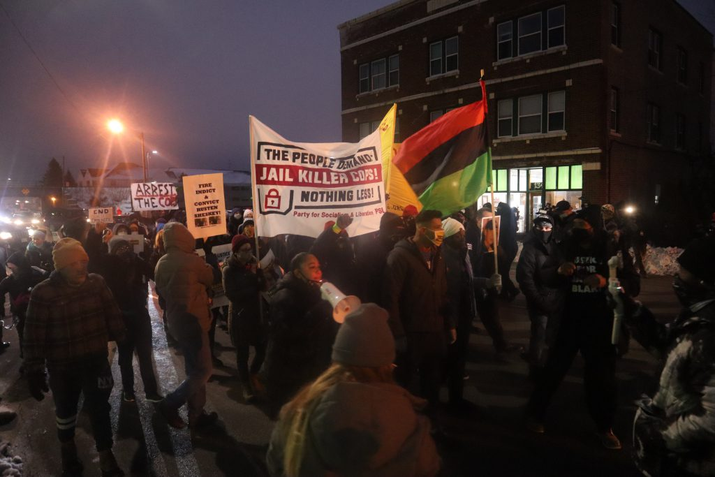 Protesters take to the streets on Jan. 4 in Kenosha. Photo by Isiah Holmes/Wisconsin Examiner.