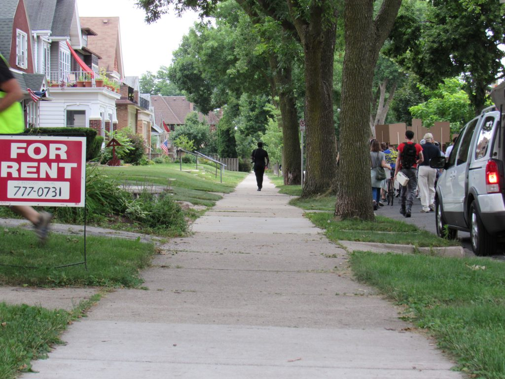 Tom Barrett's house, to demand a freeze on evictions. Photo by Isiah Holmes/Wisconsin Examiner.