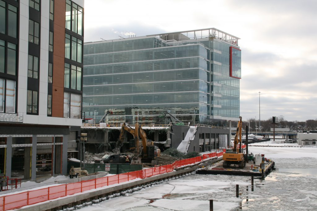 Demolition to repair damage from an explosion is underway at River One. Photo by Jeramey Jannene.