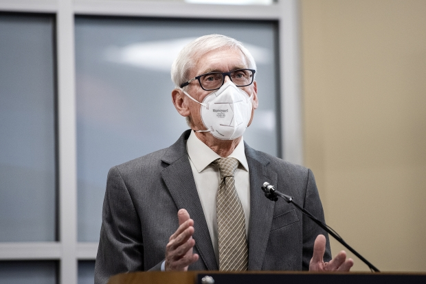 Gov. Tony Evers speaks to reporters about the future community-based coronavirus vaccination clinic Wednesday, Feb. 10, 2021, at Blackhawk Technical College in Janesville, Wis. Angela Major/WPR