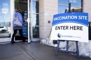 A person enters the Blackhawk Technical College community-based coronavirus vaccination clinic Tuesday, Feb. 23, 2021, in Janesville, Wis. Angela Major/WPR