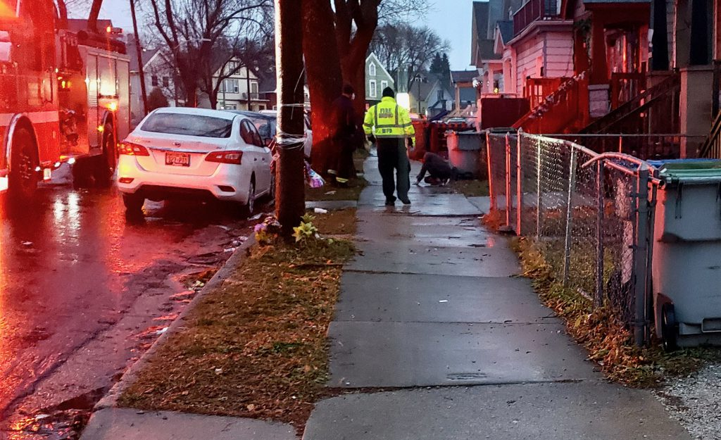 """Milwaukee Fire Department personnel respond to an emergency situation on the city's South Side. """"Resources declined, but calls for help have not been declining,"""" Acting Chief Aaron Lipski told residents last month at a community meeting. Photo by Edgar Mendez/NNS."""