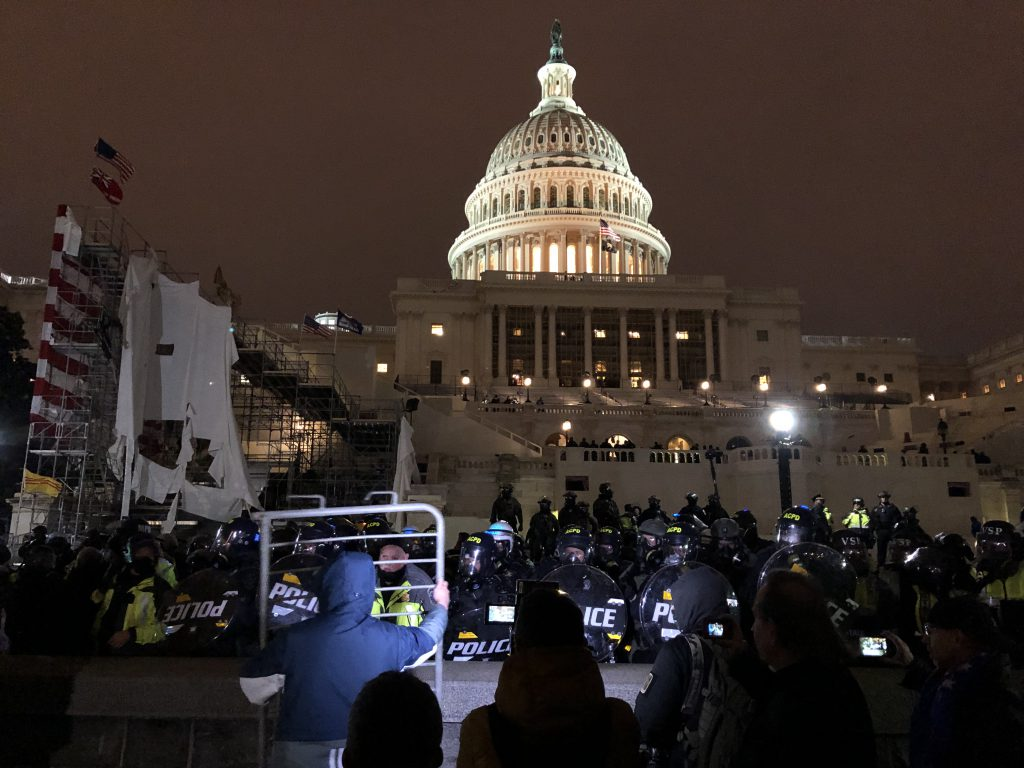 Riot police outside of the U.S. Captiol on January 6th, 2021. Photo by Tyler Merbler, CC BY 2.0 , via Wikimedia Commons