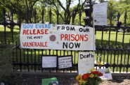 "Signs and posters are left outside the Wisconsin governor's mansion in Maple Bluff, Wis., on June 18, 2020, as part of a ""Drive to Decarcerate"" event. Those attending urged Gov. Tony Evers to release inmates from Wisconsin's overcrowded prisons to slow the spread of COVID-19. Before the pandemic, Evers set a goal to cut the state's prison population in half. But 23 state prisons still exceed their designed capacity. Photo by Coburn Dukehart / Wisconsin Watch"