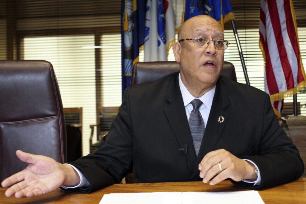 "Kevin Carr, secretary of the Wisconsin Department of Corrections, told WISN-TV in January that prioritizing inmates in the state's vaccination plan would also protect prison staff and ""the communities where our facilities are located"" against COVID-19. He is seen during an interview with Wisconsin Watch at the department's headquarters in Madison, Wis., on June 19, 2019. Alisa Ivanitskaya / Wisconsin Watch"