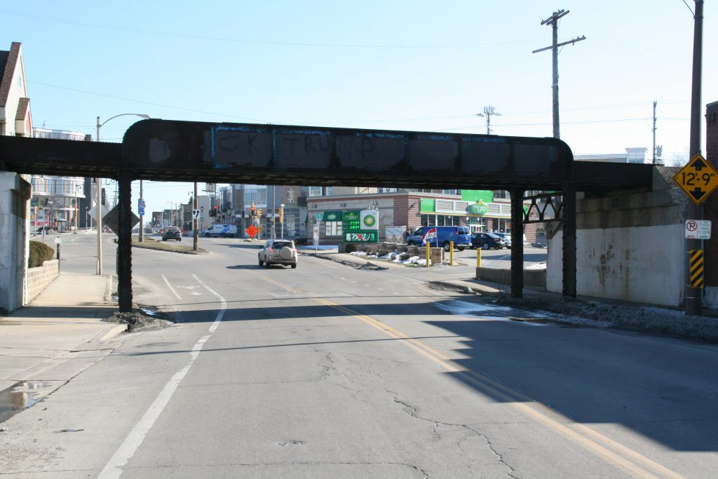 Railroad bridge over S. Kinnickinnic Ave. The roadway will be lowered to accommodate larger trucks entering and exiting Komatsu's South Harbor Campus. Photo by Jeramey Jannene.