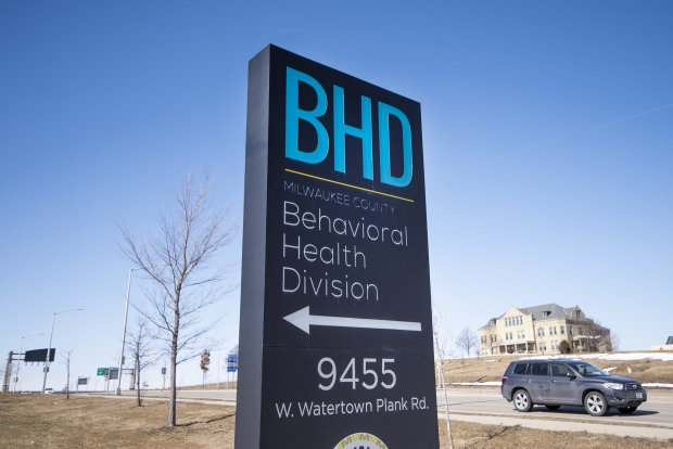 Vehicles drive past the Behavioral Health Division Psychiatric Crisis Services facility Friday, March 5, 2021, in Milwaukee, Wis. Angela Major/WPR