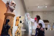 Ashley Stangel and her 5-year-old son, Sullivan, look at art Friday, March 5, 2021, at the Milwaukee Art Museum. Angela Major/WPR
