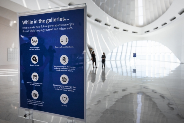 A sign instructs Milwaukee Art Museum guests on safety protocols Friday, March 5, 2021. The museum re-opened for the first time in months after being shut down due to COVID-19. Angela Major/WPR
