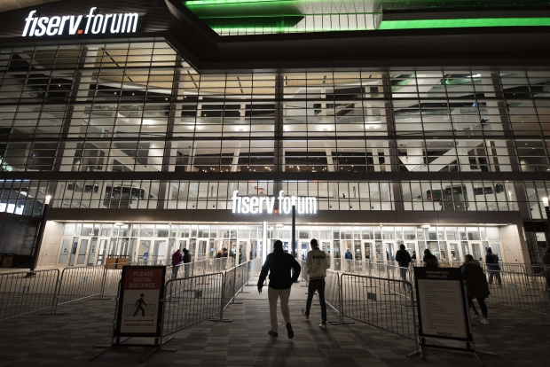 Basketball fans walk into the Fiserv Forum to watch the Milwaukee Bucks play the Denver Nuggets on Tuesday, March 2, 2021, in Milwaukee, Wis. Angela Major/WPR