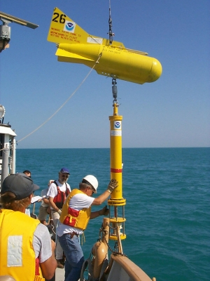 Scientists with NOAA's Great Lakes Environmental Research Lab deploy what's known as a thermistor chain to conduct long-term temperature monitoring in southern Lake Michigan in 1999. Photo courtesy of NOAA's Great Lakes Environmental Research Lab