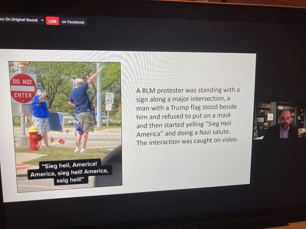 A counterprotester gives a Nazi salute at a Black Lives Matter event in Milwaukee. Screenshot from a March 3 presentation by Milwaukee Jewish Federation.