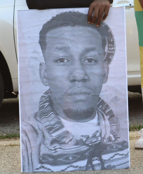 A poster depicting Christopher Davis. Photo by Isiah Holmes/Wisconsin Examiner.