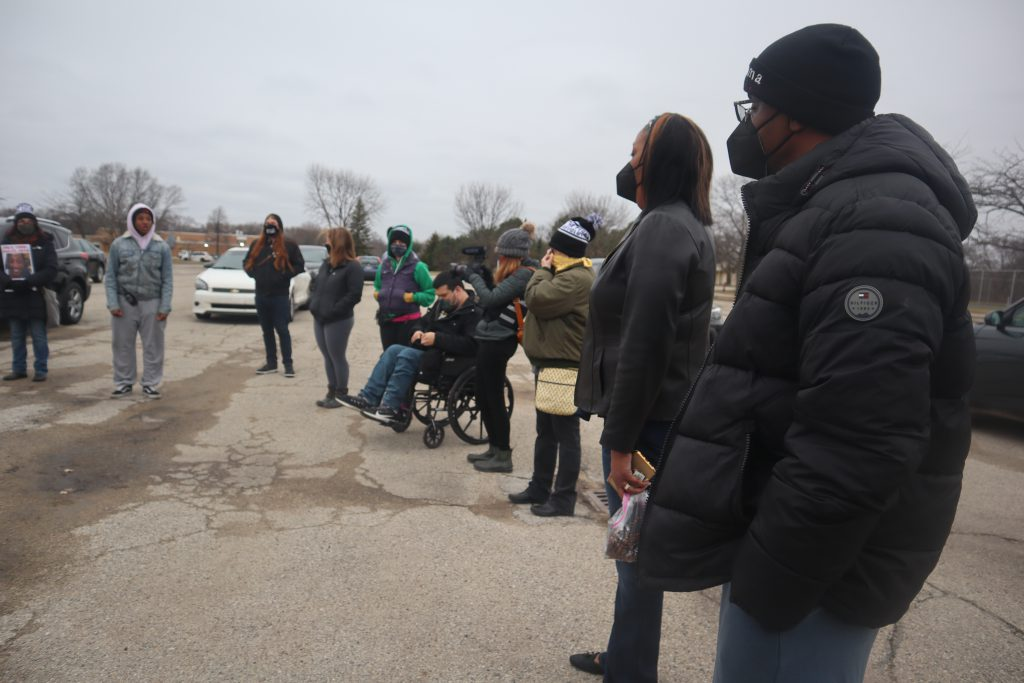 Jay Sr. and Linda Anderson, the parents of Jay Anderson Jr., (right) stand with protesters gathering in Madison Park. Anderson was killed in the parking lot in 2016 by a former Wauwatosa officer. Photo by Isiah Holmes/Wisconsin Examiner