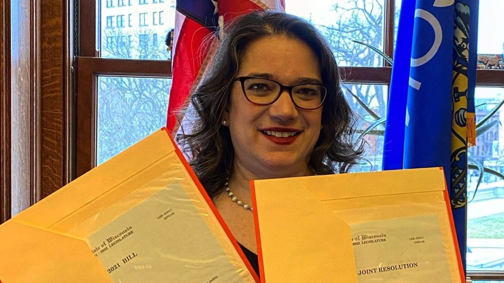 Sen. Melissa Agard holding copies of her public hearing petition bill. Photo from Agard's Facebook page.