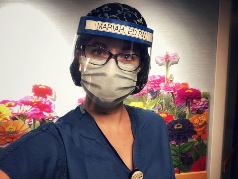 Mariah Clark is an emergency room nurse who works at UW Health. She is seen here in the personal protective equipment (PPE) that she wore at work at the beginning of the pandemic. Courtesy of Mariah Clark