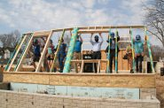Raising the front wall at the Habitat for Humanity house at 3455 N. 3rd St. Photo by Jeramey Jannene.