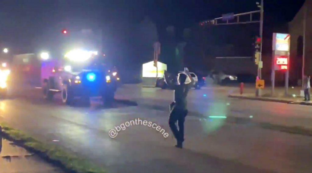 A video posted on Twitter shows Kyle Rittenhouse approaching police with his hands up after killing two people in Kenosha and wounding another on Aug. 25, 2020. Police did not immediately arrest him, even as onlookers yelled that he was the shooter. Rittenhouse was later arrested in Illinois and is set to face trial on multiple charges including two counts of first-degree homicide. His lawyers are claiming self defense. Credit: Courtesy of Brendan Gutenschwager via Twitter
