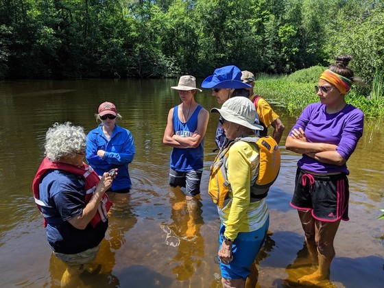 DNR Conservation Biologist Lisie Kitchel talks about native mussels with volunteers before they survey for native mussels in northern Wisconsin in 2019. / Photo Credit: Wisconsin DNR